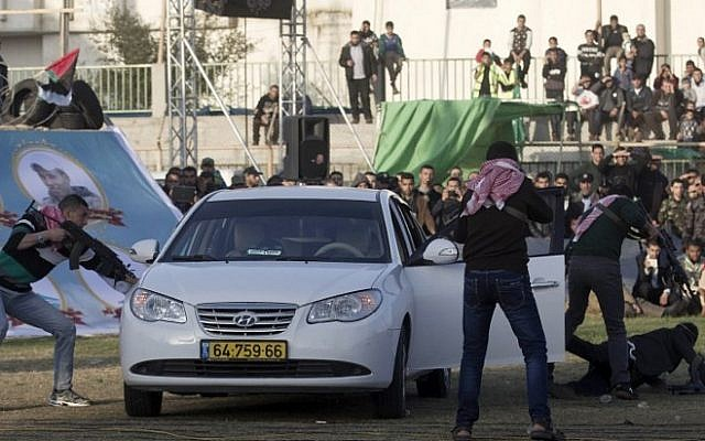 Palestinian boys simulate an attack on an Israeli car during a show as part of an anti-Israel rally on February 26, 2016, in the southern Gaza Strip town of Rafah. (AFP / SAID KHATIB)
