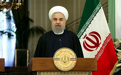 Iranian President Hassan Rouhani speaks during a press-conference following a meeting his Swiss counterpart in the capital Tehran, on February 27, 2016. (AFP/ATTA KENARE)