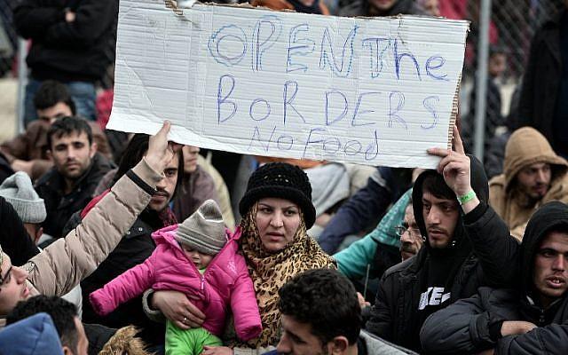 Refugees protest at the railroad tracks near the Greek-Macedonian borders near the village of Idomeni on February 28, 2016. (AFP / LOUISA GOULIAMAKI)