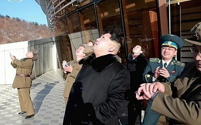 This picture taken from North Korean TV and released by South Korean news agency Yonhap on February 7, 2016, shows North Korean leader Kim Jong Un (center), looking at the locket launch of the satellite Kwangmyong 4. (AFP/North Korean TV via Yonhap)