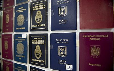 Fake passports are displayed at the immigration bureau in Bangkok on February 10, 2016, after Thai police broke up a major fake passport ring led by an Iranian known as 'The Doctor' which sent thousands of passports to Middle Eastern customers trying to enter Europe. (AFP PHOTO / NICOLAS ASFOURI)