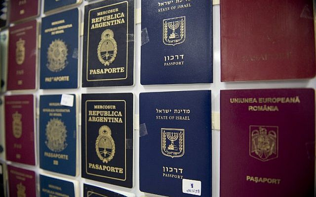 """Fake passports are displayed at the immigration bureau in Bangkok on February 10, 2016 after Thai police broke up a major fake passport ring led by an Iranian known as """"The Doctor"""" which sent thousands of passports to Middle Eastern customers trying to enter Europe. (AFP PHOTO / NICOLAS ASFOURI)"""