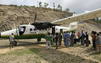 A June 1, 2010 image of a Tara Air DHC-6 Twin Otter aircraft, similar to one that went missing early on February 24, 2016 with 21 people on board, at the Lamidanda airstrip some 120 kms east of Kathmandu. (AFP PHOTO / Prakash MATHEMA)