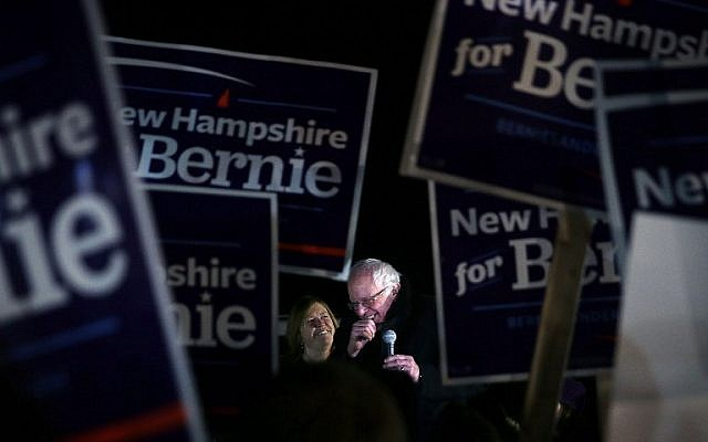 Democratic presidential candidate Sen. Bernie Sanders speaks to supporters as his wife Jane O'Meara Sanders looks on February 2, 2016 in Concord, New Hampshire. (Alex Wong/Getty Images/AFP)