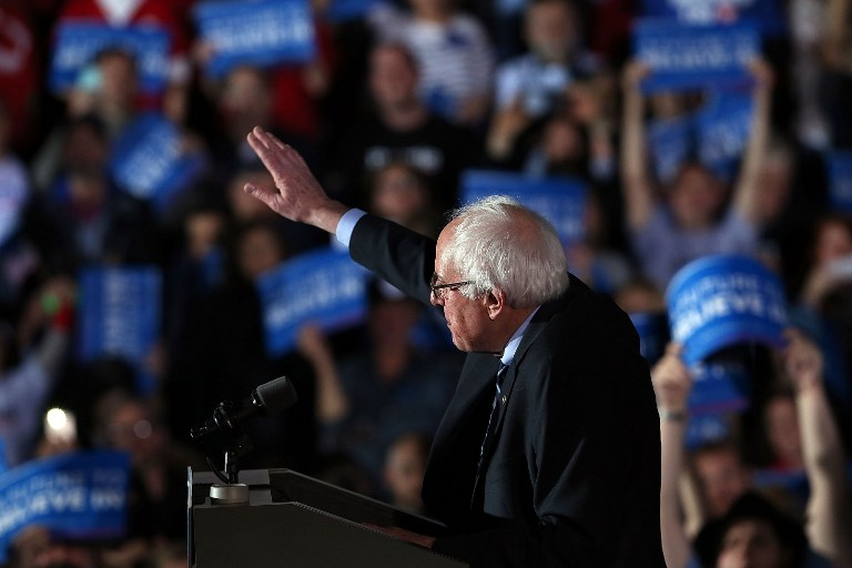 CONCORD, NH - FEBRUARY 09: Sen. Bernie Sanders (D-VT) speaks on stage after declaring victory over Hillary Clinton in the New Hampshire Primary on February 9, 2016 in Concord, New Hampshire. Sanders was projected the winner shortly after the polls closed. Spencer Platt/Getty Images/AFP