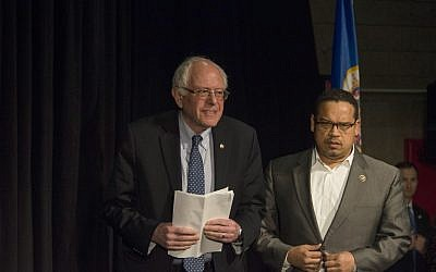 Rep. Keith Ellison (D-MN) introduces Democratic presidential candidate Sen. Bernie Sanders (D-VT) at a forum on race and economic opportunity at Patrick Henry High School on February 12, 2016 in Minneapolis, Minnesota. (Stephen Maturen/Getty Images/AFP)