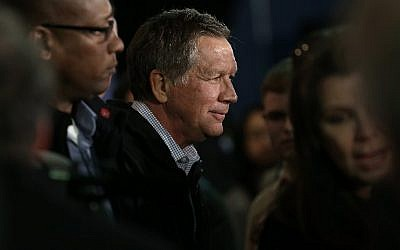 Republican presidential candidate Ohio Gov. John Kasich greets South Carolina voters after delivering remarks aboard the USS Yorktown during a campaign appearance on February 19, 2016 in Mount Pleasant, South Carolina. (Win McNamee/Getty Images/AFP)