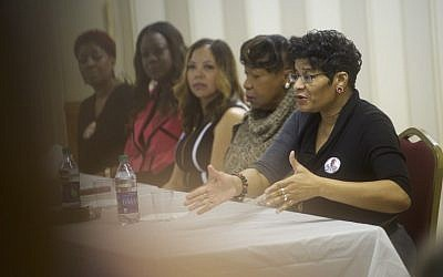 Right, Geneva Reed-Veal, mother of Sandra Bland, whose child was killed by gun violence, speaks during a Hillary Clinton for South Carolina 'Breaking Down Barriers' forum on February 22, 2016 at the Mt. Zion Missionary Baptist Church in Sumter, South Carolina. The participants were Sybrina Fulton, mother of Trayvon Martin; Geneva Reed-Veal, mother of Sandra Bland; Gwen Carr, mother of Eric Garner; Maria Hamilton, mother of Dontre Hamilton; and Lucy McBath, mother of Jordan Davis. (Mark Makela/Getty Images/AFP)