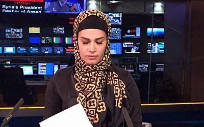 Photo shows Sheena Shirani sitting at the news desk at Press TV.  (Facebook)