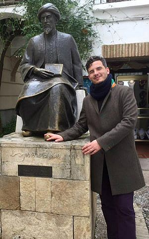 Haim Casas poses at the statue of Maimonides in Cordoba, Spain. (Courtesy)