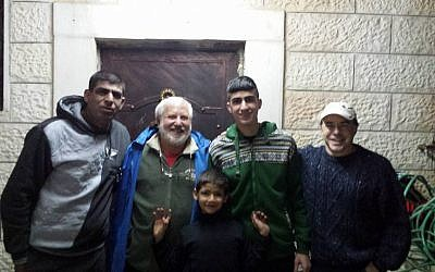 From left to right, Ziad Sabateen, Lonny Baskin, Mustafa Sabateen, Muhammad Sabateen and Phil Saunders pose for a photograph on the night of Muhammad's release after a three-month prison sentence. (Courtesy/Ziad Sabateen)