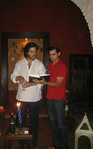 Haim Casas (left) leads havdalah at Casa de Sefarad in Cordoba, Spain, 2011. (Courtesy)