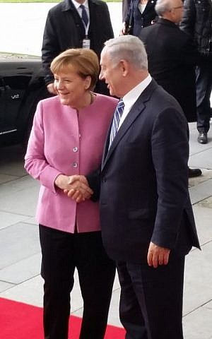 Prime Minister Benjamin Netanyahu, right, being greeted by German Chancellor Angela Merkel on Berlin on February 16, 2016. (Raphael Ahren/Times of Israel)