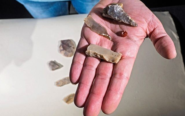 Polished flint ax and blades, and a gemstone bead dating back 7,000 years, found during archaeological excavations in the Shuafat neighborhood, northern Jerusalem. (Assaf Peretz/Israel Antiquities Authority)