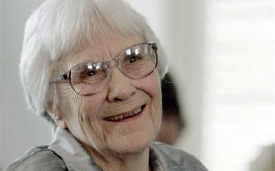 In this Aug. 20, 2007, file photo, author Harper Lee smiles during a ceremony honoring the four new members of the Alabama Academy of Honor at the Capitol in Montgomery, Alabama. (AP Photo/Rob Carr, File)