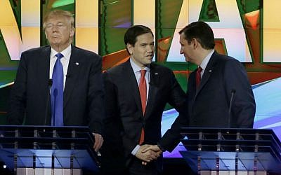 Republican presidential candidate Donald Trump (left), pauses as fellow candidates Sen. Marco Rubio (R-Florida, center), and Sen. Ted Cruz (R-Texas), greet at a break during a Republican presidential primary debate at the University of Houston in Houston, Texas, February 25, 2016. (AP/David J. Phillip)