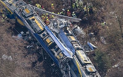Aerial view of rescue forces working at the site of a train accident near Bad Aibling, Germany, Tuesday, Feb. 9, 2016 (Peter Kneffel/dpa via AP)