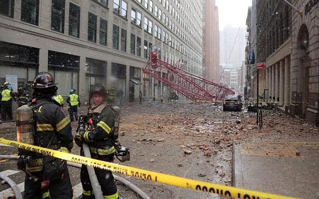 A collapsed crane lies on the street on Friday, Feb. 5, 2016, in New York. (AP Photo/Bebeto Matthews)