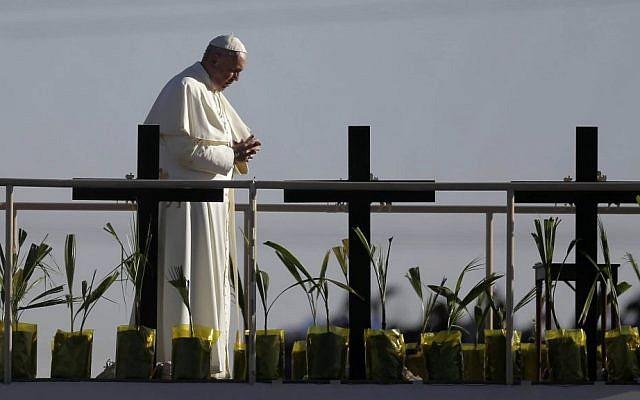 Pope Francis stands on a platform near the US-Mexico border fence along the Rio Grande, in Ciudad Juarez, Mexico, Wednesday, Feb. 17, 2016, as seen from in El Paso, Texas. (AP Photo/Eric Gay)