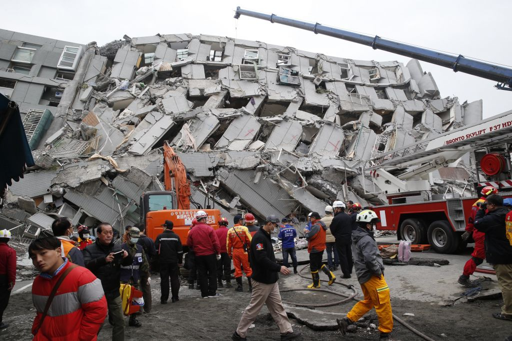 Rescue workers search a collapsed building from an early morning earthquake in Tainan, Taiwan, Saturday, Feb. 6, 2016. (Wally Santana/AP)