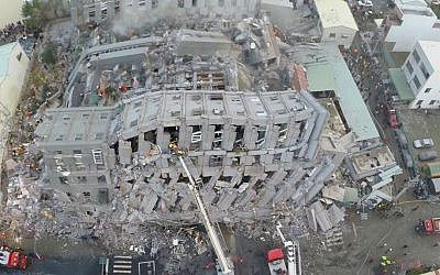 In this photo taken from a drone, rescue workers search a collapsed building from an early morning earthquake in Tainan, Taiwan, Saturday, Feb. 6, 2016. (AP Photo)