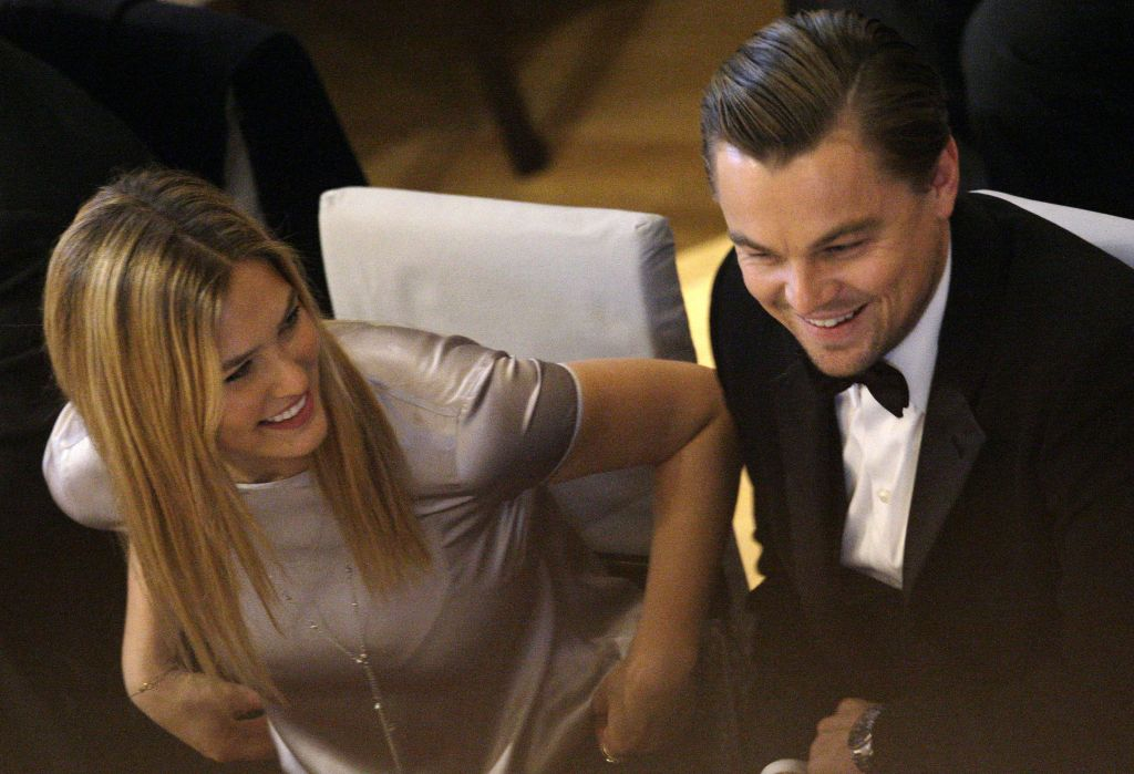 Israeli model Bar Refaeli and U.S. actor Leonardo DiCaprio during the ceremony for the 'Cinema for Peace Gala 2010' during the International Film Festival Berlinale in Berlin, Germany, Monday, Feb. 15, 2010. (AP Photo/Joel Ryan)
