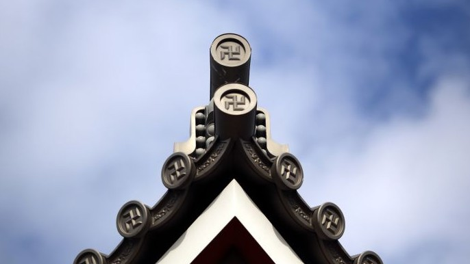 "The roof of a temple in Tokyo marked with the ""manji"" symbol, the mirror image of a swastika, which comes from the ancient Sanskrit and has been widely used for centuries to denote Buddhist temples on maps and elsewhere, February 3, 2016 (AP Photo/Eugene Hoshiko)"