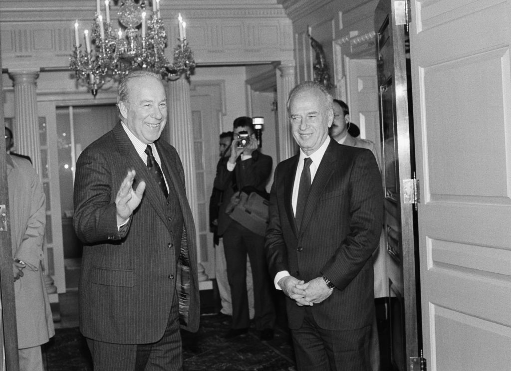 Secretary of State George Shultz, left, greets Defense Minister Yitzhak Rabin at the State Department in Washington on Monday, January 28, 1985 (AP Photo/Ira Schwarz)