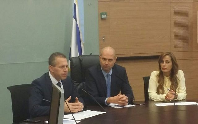 Likud MK Amir Ohana (center) flanked by Public Security Minister Gilad Erdan (left) and Likud MK Nava Boker in the first meeting of a Knesset caucus on lobbying for less restrictive gun control at the Knesset in Jerusalem on Monday, February 15 2016. (Knesset)