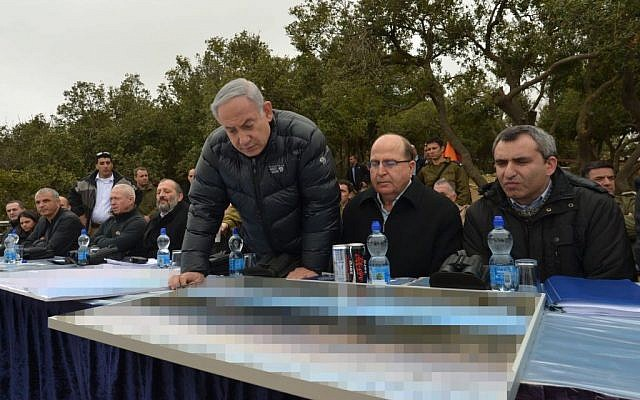 Prime Minister Benjamin Netanyahu, Defense Minister Moshe Ya'alon and Absorption Minister Ze'ev Elkin on a tour of Israel's north on Tuesday, February 2, 2016 (Prime Minister's Office)