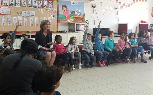 Samantha Power, the adult, with schoolchildren in Jerusalem on February 15, 2016. (Marissa Newman/Times of Israel)