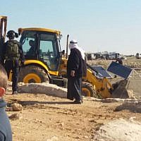 Soldiers from Israel's Civil Administration demolish a number of structures deemed illegal in the southern Hebron Hills on February 2, 2016. (Nasser Nawaja/B'Tselem)