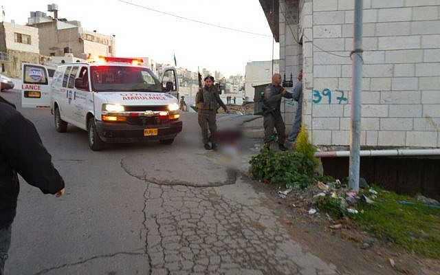 An ambulance arrives on the scene of an attempted stabbing attack near the Tomb of the Patriarchs in Hebron on February 14, 2016. (Yishai Fleisher)