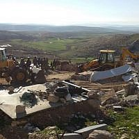 File: Soldiers from Israel's Civil Administration demolish a number of structures deemed illegal in the southern Hebron Hills on February 2, 2016. (Nasser Nawaja/B'Tselem)