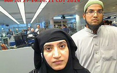 This July 27, 2014, photo provided by U.S. Customs and Border Protection shows Tashfeen Malik, left, and Syed Farook, as they passed through O'Hare International Airport in Chicago. A U.S. magistrate has ordered Apple to help the Obama administration hack into an iPhone belonging to one of the shooters in San Bernardino, Calif. on Feb. 16, 2016  (U.S. Customs and Border Protection via AP)