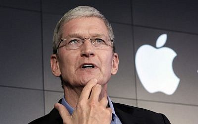 In this April 30, 2015, file photo, Apple CEO Tim Cook responds to a question during a news conference at IBM Watson headquarters, in New York. Cook said his company will resist a federal magistrate's order to hack its own users in connection with the investigation of the San Bernardino, Calif., shootings. In a statement posted early Wednesday, Feb. 17, 2016  (AP Photo/Richard Drew, File)