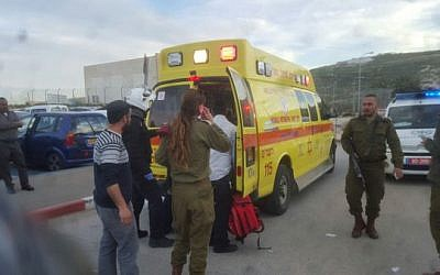 Rescue personnel at the scene of a stabbing attack north of Jerusalem on Thursday, February 18, 2016 (United Hatzalah)
