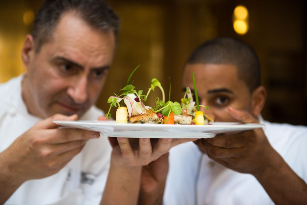 Chef Itzik Barak and Chef JJ, a visiting New York City chef, take a final glance at the salad entry (Courtesy Sarka Babicka)