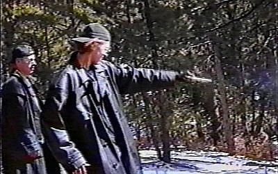 Eric Harris (L) watches as Dylan Klebold practices shooting a gun at a makeshift shooting range March 6, 1999 in Douglas County, CO in this image from video released by the Jefferson County Sheriff's Department. (Photo by Jefferson County Sheriff's Department/JTA via Getty Images)