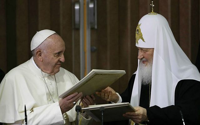 Pope Francis, left, embraces Russian Orthodox Patriarch Kirill after signing a joint declaration on religious unity at the Jose Marti International airport in Havana, Cuba, Friday, Feb. 12, 2016 (AP Photo/Gregorio Borgia, Pool)