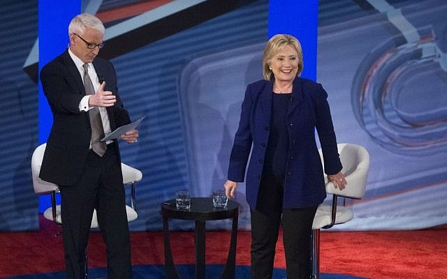 Democratic presidential candidate Hillary Clinton, right, stands to answer a question from the audience alongside host Anderson Cooper during a Democratic primary town hall sponsored by CNN, Wednesday, February 3, 2016, in Derry, N.H. (AP/John Minchillo)