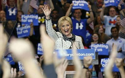Democratic presidential candidate Hillary Clinton acknowledges supporters at her election night watch party after winning the South Carolina Democratic primary in Columbia, South Carolina, Saturday, Feb. 27, 2016. (AP Photo/Gerald Herbert)