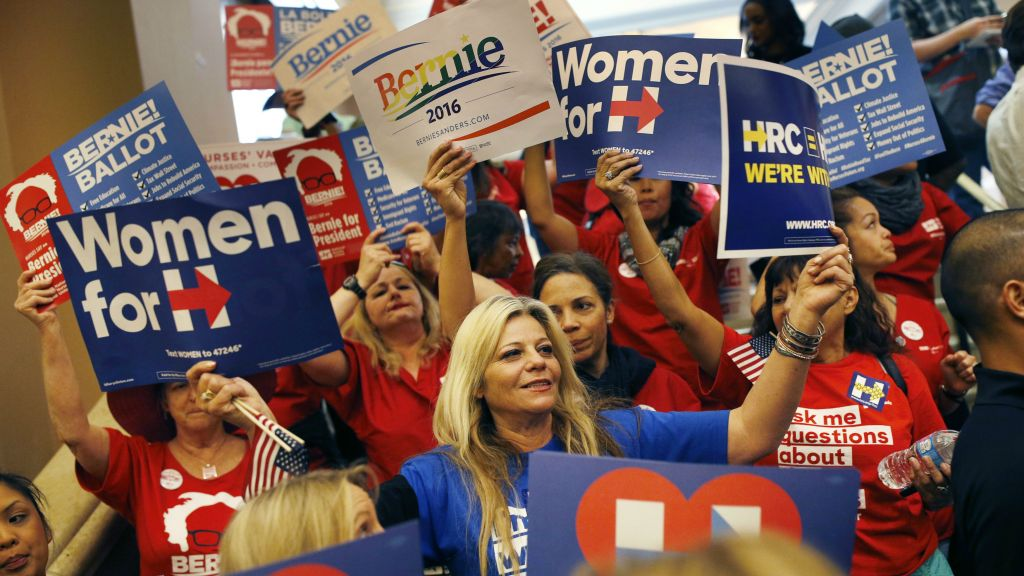 Supporters of Hillary Clinton and Bernie Sanders cheer on their presidential candidates before entering a caucus site during the Nevada Democratic caucus, Saturday, Feb. 20, 2016, in Las Vegas. (AP Photo/John Locher)