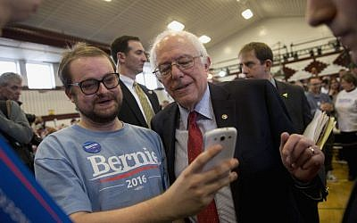 Democratic presidential candidate, Sen. Bernie Sanders, I-Vt. pauses for a photo with a supporter at a rally, Friday, Feb. 19, 2016, in Elko, Nev. (AP Photo/Jae C. Hong)