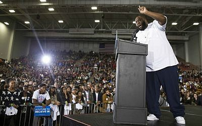 Hip hop artist and activist Killer Mike speaks during a rally with Democratic presidential candidate Sen. Bernie Sanders, I-Vermont, at Morehouse College in Atlanta, Tuesday, Feb. 16, 2016. (AP Photo/Evan Vucci)