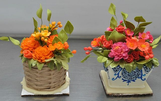 Miniature cakes by Sylvia Weinstock, who specializes in making lifelike sugar flowers. (Courtesy)