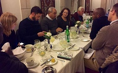Members of a visiting South African group dine with Mohammad Darawshe (fourth from left) at the American Colony Hotel in Jerusalem, February 2016. (Eliana Rudee)