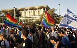 Illustrative: Israelis walking past the Knesset during the annual gay parade in Jerusalem, July 29, 2010. (Miriam Alster/FLASH90)