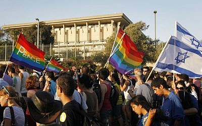 Israelis walking past the Knesset during the annual gay parade in Jerusalem, July 29, 2010. (Miriam Alster/Flash90)