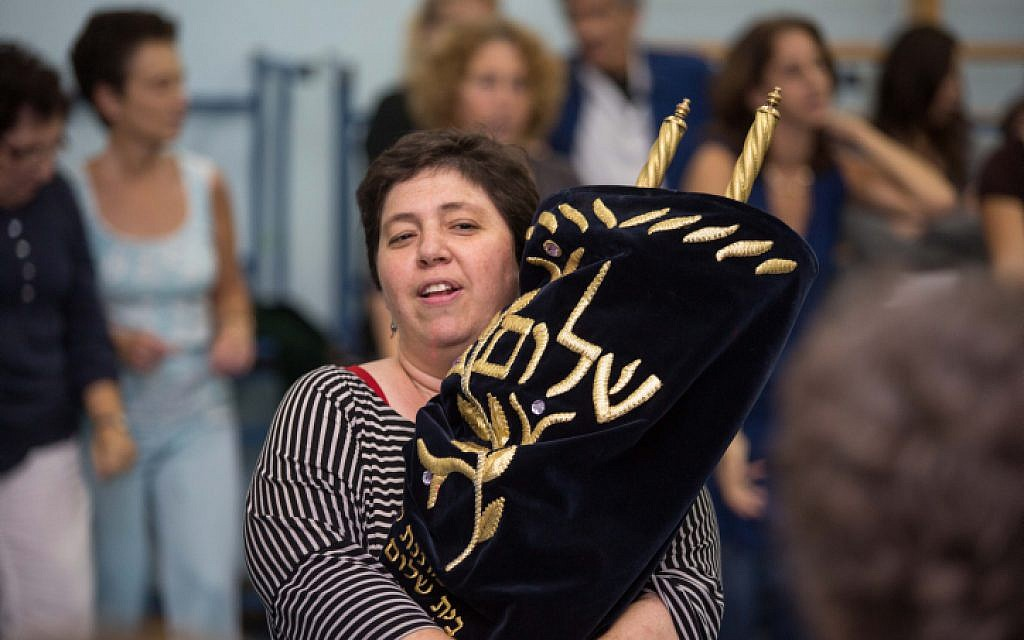 Reform Jews from 'Kol Haneshama' congregation in Kiryat Yovel  sing and dance as they carry Torah scrolls  during the celebration of Simhat Torah at the end of the Jewish holiday of Sukkot, on Oct 8,2012. (Oren Nahshon / FLASH90)